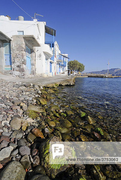 Houses on the water's edge  fishing village of Milos  Cyclades  Greece  Europe