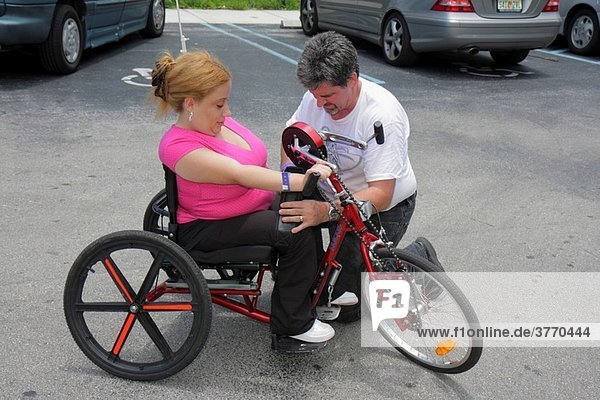 Florida  Miami  Coconut Grove  Shake-a-Leg Miami  No Barriers Festival  disabled  physical disability  handicapped  woman  man  hand-operated tricycle  mobility adaptive sports  exercise  overcoming obstacles