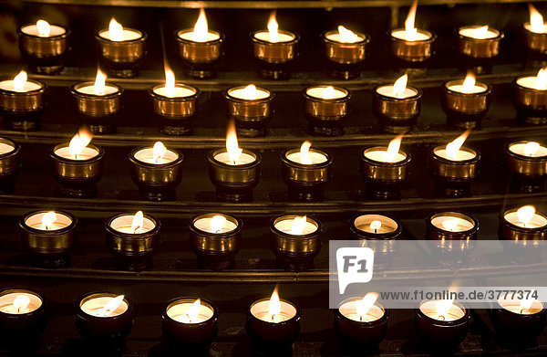 Many candles in a church - for All Saints' Day