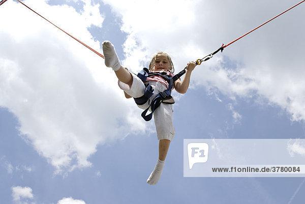Girl jumping bungee trampoline