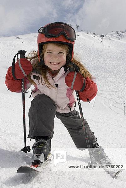 Girl with helmet skiing