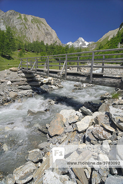 Wooden bridge over the mountain stream Koednitzbach  National Park Hohe Tauern  Tyrol  Austria
