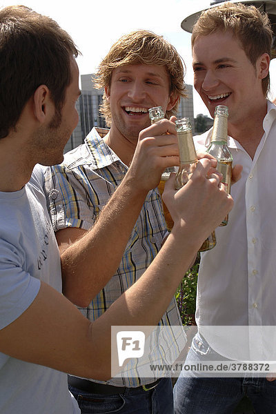 3 young men partying outside