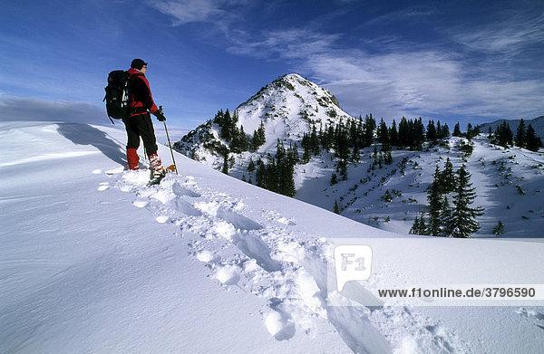 Snowshoeing near the Schildenstein Mangfall mountains Germany