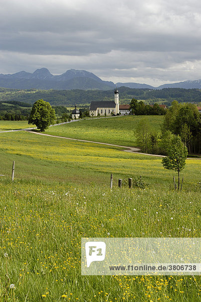 Wilparting am Irschenberg Kirche St. Anianus and Marinus near Miesbach in the background the mountain Wendelstein Upper Bavaria Germany at the Highway A8
