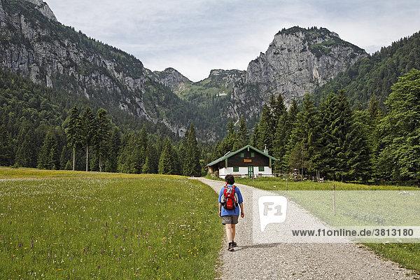 Hiker at Alpine hut in Längental valley   Upper Bavaria  Germany