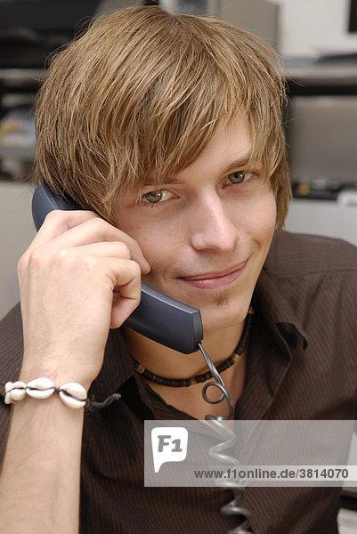 Young man phones