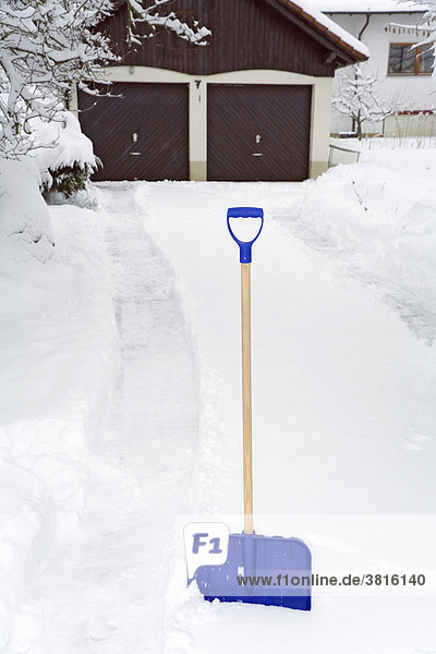 A snow shovel in front of a gateway