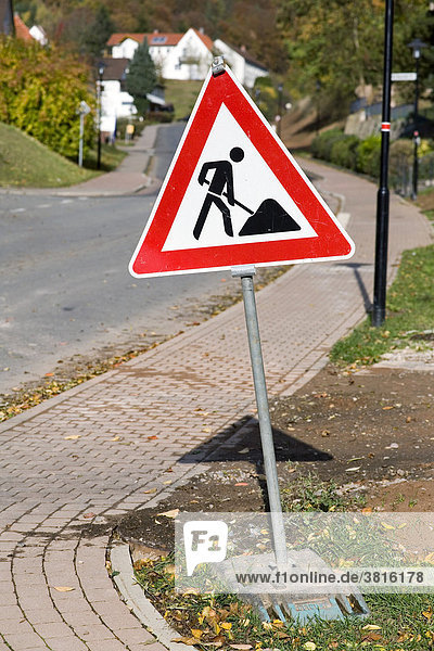 A building site sign beside a through road