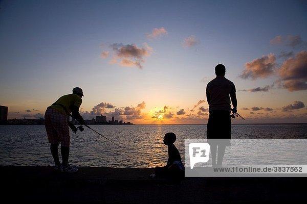Fishermen on the Malecon of Havana in Cuba