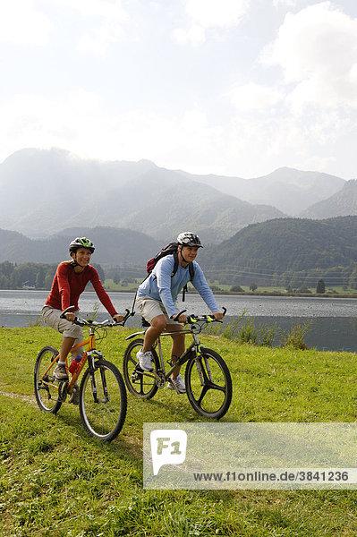 Cyclists at Kochelsee Lake  Upper Bavaria  Germany  Europe