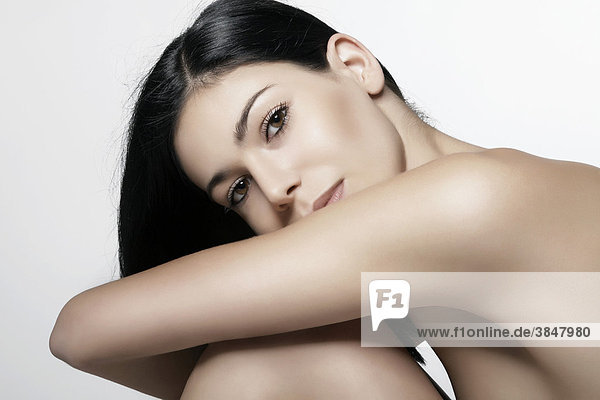 Young woman leaning her head on her knee  beauty