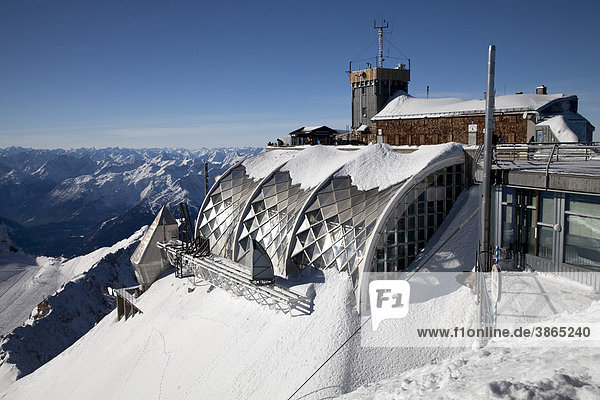 2962m  Alps  architecture  Bavaria  Bavarian  building  buildings  capped  chain  chains  covered  day  daylight  daytime  during  Europe  European  exterior  exteriors  Federal  forecast  FRG  German  Germany  Haus  hut  look  look-out  look-outs  lookout  lookouts  meteorology  metereological  meterological  modern  Mountain  mountain  mountained  mountainous  mountains  Muenchner  of  office  offices  out  outdoor  outs  photo  photos  range  ranges  rangy  Republic  shot  shots  snow  snowy  Southern  station  stations  the  view  views  weather  winter  wintertime  wintery  wintry  Zugspitze