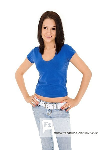 Beautiful caucasian woman standing on a white background wearing casaul clothing and smiling