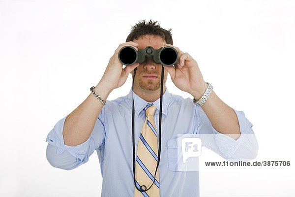 Caucasian businessman in a shirt and tie looking throught a pair of binoculars