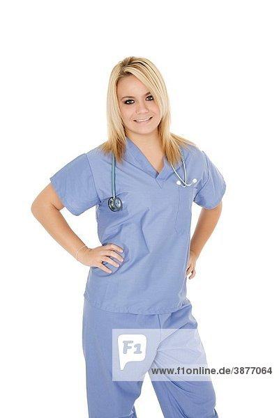 Beautiful Caucasian doctor / nurse standing on white background