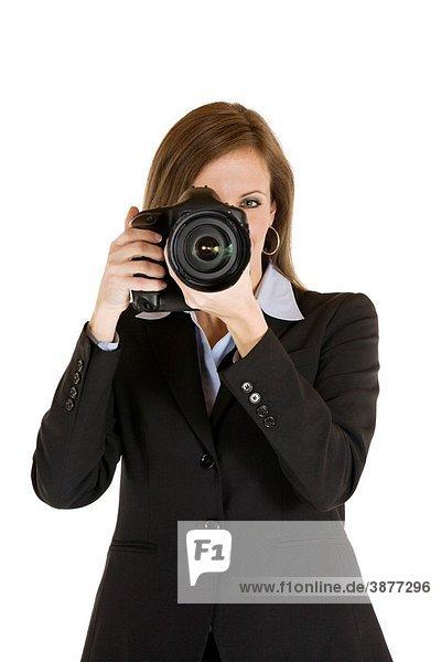Caucasian businesswoman holding a camera
