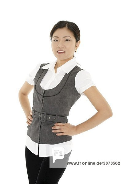 A beautiful and confident Asian businesswoman on white background
