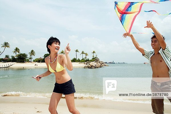 Young asian couple with kite