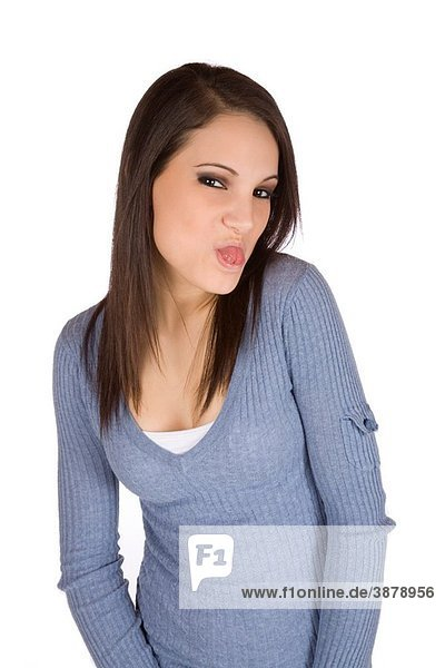 Caucasian woman acting silly sticking out her tongue