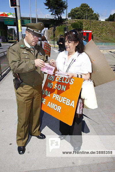 Woman with poster talking to a policeman  anti-violence demonstration of women  ConcepciÛn  Chile  South America