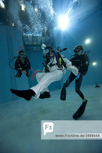 Backup divers and astronauts practicing with a space station module reproduction in a diving basin  European Space Agency  ESA  European Astronaut Center  EAC  Cologne  North Rhine-Westphalia  Germany  Europe