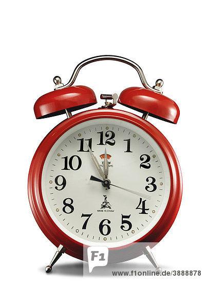 Wecker  der fünf Minuten vor zwölf anzeigt
