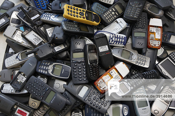 Cell phones  old mobile phones on a pile