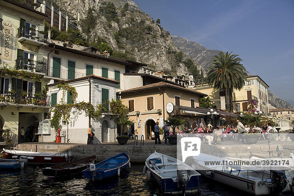 Limone sul Garda harbour on the lake with boats and touristic hotels and restaurants in the bay  Lake Garda  Italy  Europe