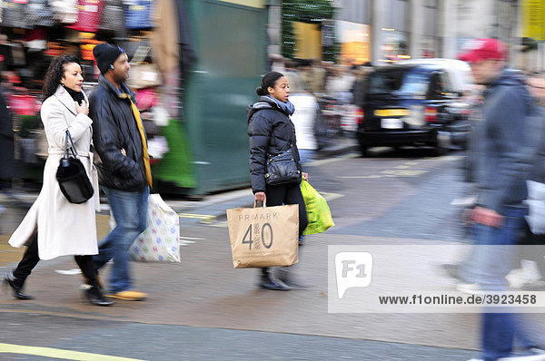 Pedestrians with shopping bags on Oxford Street  London  England  United Kingdom  Europe