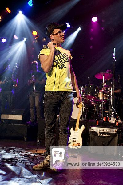Georg Mueller  singer and frontman of the German funk band Schein  live at the winter festival in Wolhusen  Lucerne  Switzerland