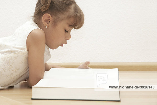 Six-year-old girl reading a book