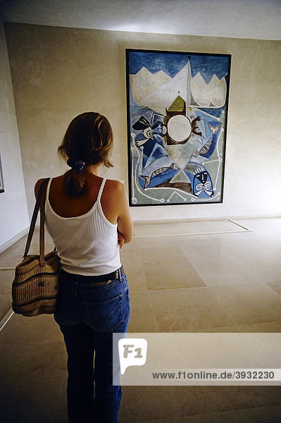 Young woman viewing a painting by Picasso  Picasso Museum in the Chateau Grimaldi  Antibes  Cote d'Azur  Var  Southern France  France  Europe