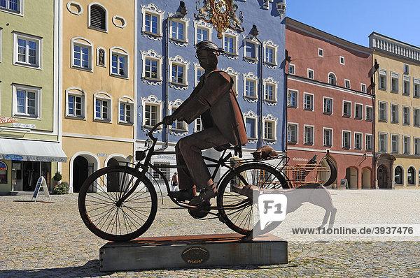 Artwork on the Stadtplatz town square  cyclists with dog by Edgardo Carmona Vergara  Stadtplatz town square  Burghausen  Upper Bavaria  Germany  Europe