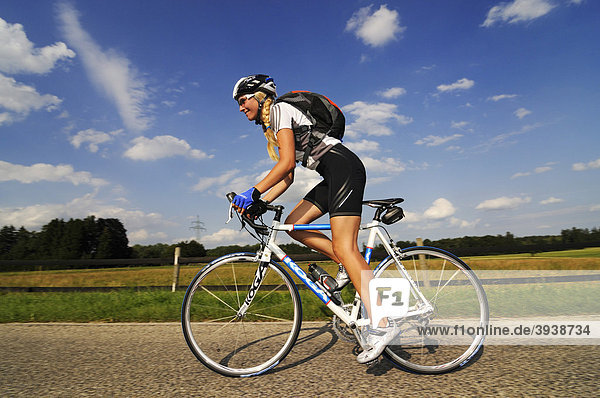 Young woman riding a bicycle  Bavaria  Germany  Europe