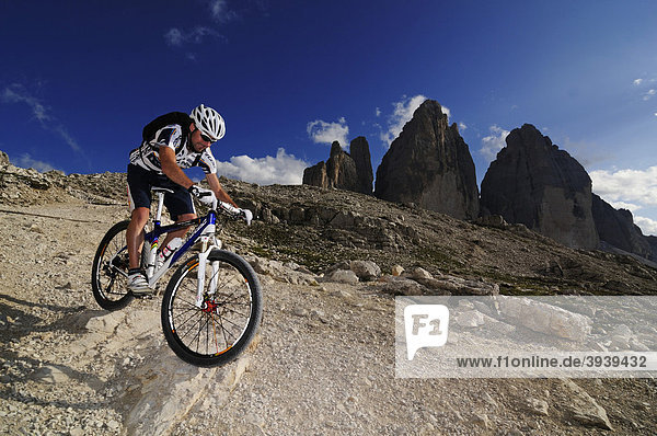 Mountain bike pro Roland Stauder in front of the Tre Cime di Lavaredo  Three Peaks  Alta Pusteria  Dolomites  South Tyrol  Italy  Europe
