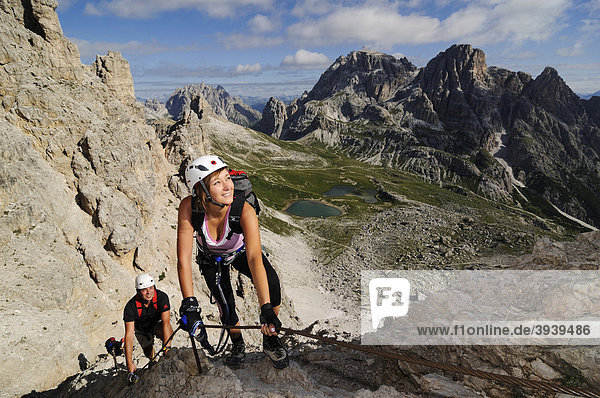 Climbers at a via ferrata tour to Mt. Paternkofel  Hochpustertal  Sexten Dolomites  South Tyrol  Italy  Europe