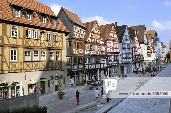 Main street with a row of half-timbered houses  Ochsenfurt  Franconia  Bavaria  Germany