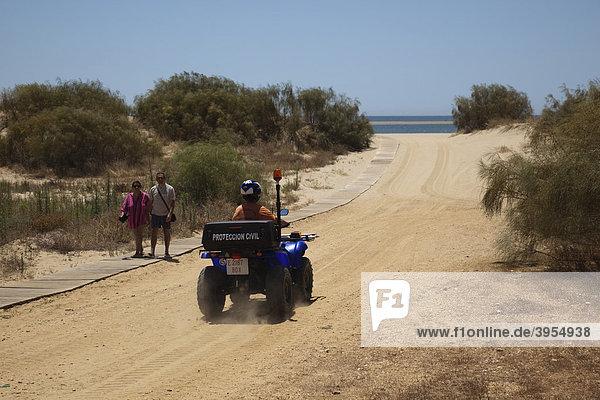 Private security on a quad bike in Isla Canela  Costa de la Luz  Andalusia  Spain  Europe