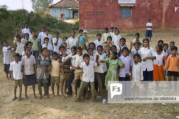 Children in front of their school  tribal zone around Kanha National Park  Madhya Pradesh state  India