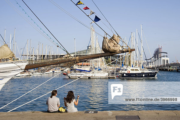 Couple seated at Port Vell  Barcelona  Catalonia  Spain  Europe