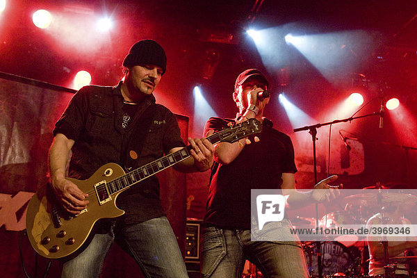 Hef Haefliger  guitar  and Nobi Suppiger  vocals  of the Swiss hard rock band Maxxwell live at the Schueuer Lucerne  Switzerland
