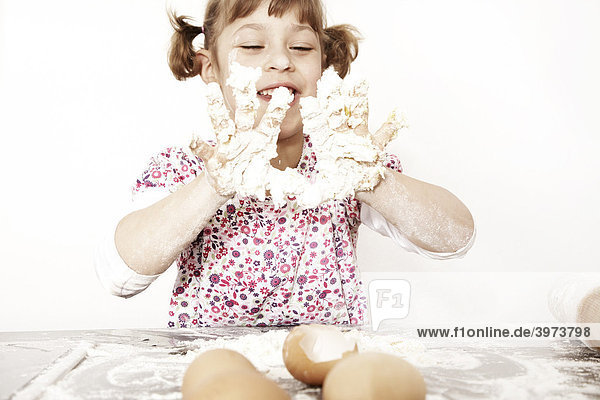 Six-year-old girl  baking