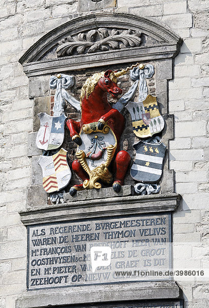 City arms with unicorn and inscription at the historic fortified tower Hoofdtoren  harbour of Hoorn  IJsselmeer  Province of North Holland  Netherlands  Europe