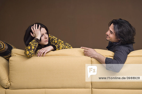 Girls leaning on a sofa  talking to her boyfriend