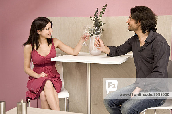 Young couple toasting each other