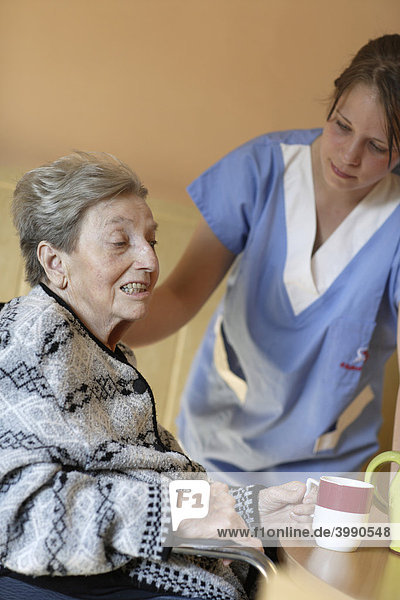 Nursing home  elderly woman with a nurse