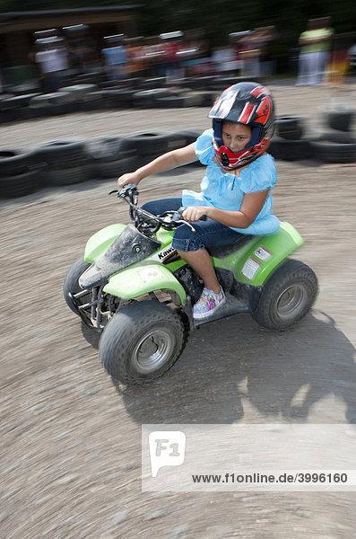 Child riding a quad bike  Hesse  Germany  Europe