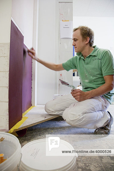 Master Craftman student applying paint with a spatula during his apprenticeship  Master Craftmans School of the Chamber of Small Industries and Skilled Trades for painting and varnishing  Dusseldorf  North Rhine-Westphalia  Germany  Europe