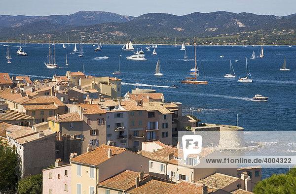 View over the roofs on the bay of Saint-Tropez during the sailing regatta Les Voiles de Saint-Tropez in Saint-Tropez  Departement Var  Cote d'Azur  Provence  Southern France  France